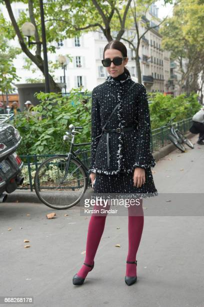 Editor at Grazia Arabia Samantha de Reviziis wears a Paule Ka jacket and skirt Chanel shoes and Dior sunglasses day 3 of Paris Womens Fashion Week...
