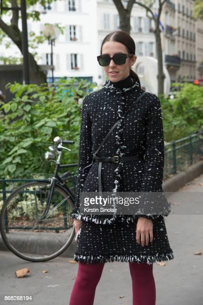 Editor at Grazia Arabia Samantha de Reviziis wears a Paule Ka jacket and skirt and Dior sunglasses day 3 of Paris Womens Fashion Week Spring/Summer...