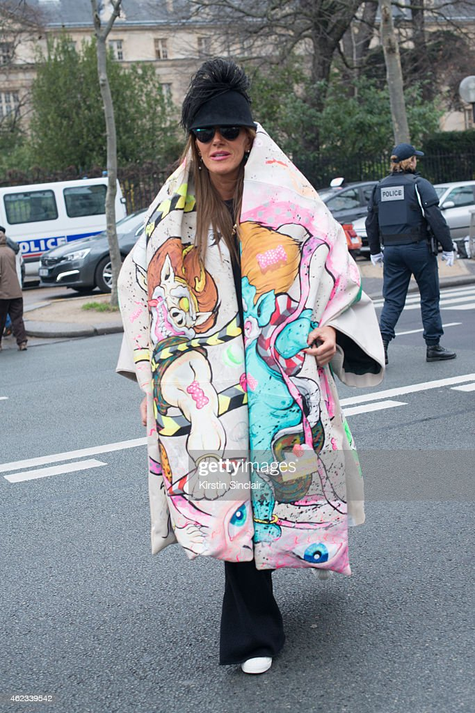 Editor at large and creative consultant for Vogue Japan Anna Dello Russo wears Adidas trainers, Yohji Yamamoto coat, and Dior sunglasses on day 2 of Paris Haute Couture Fashion Week Spring/Summer 2015, on January 26, 2015 in Paris, France.
