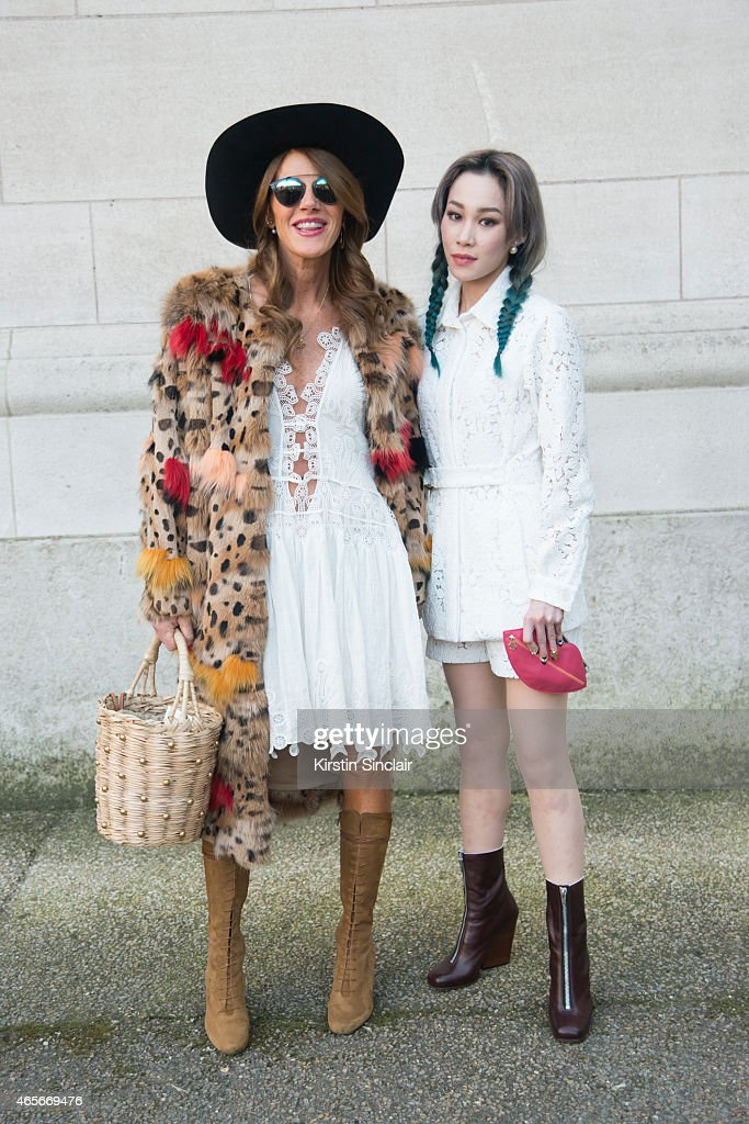 Editor at large of Vogue Japan Anna Dello Russo wears a Chloe dress with DJ and Singer Mademoiselle Yulia who wears a Chloe jacket and shorts at the Chloe show on day 6 of Paris Collections: Women on March 08, 2015 in Paris, France.