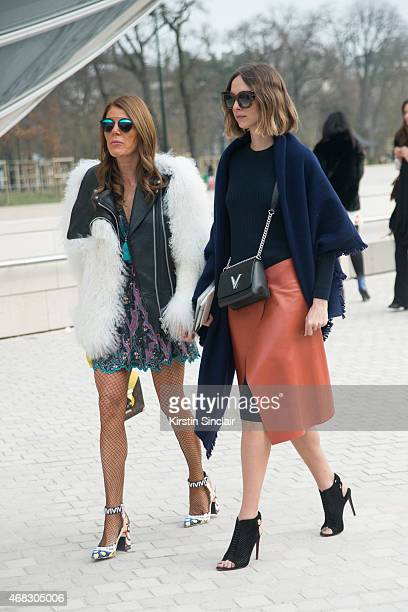 Editor at large of Vogue Japan Anna Dello Russo wears a Louis Vuitton bag and shoes with Fashion blogger Candela Novembre who wears a Louis Vuitton...