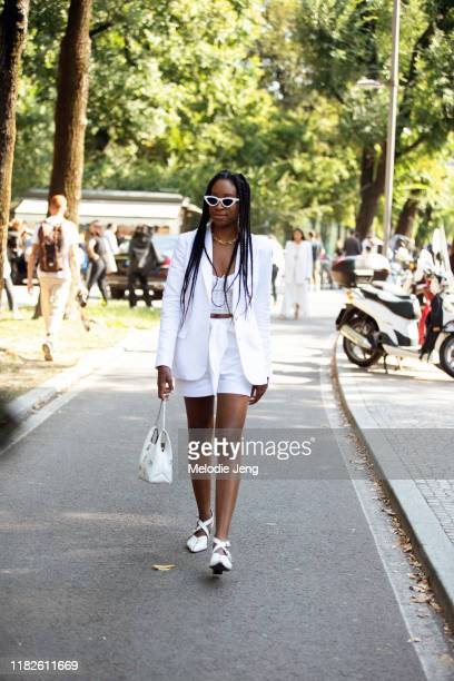 Editor Chrissy Rutherford wears an all white outfit white sunglasses white Tibi blazer white With Jéan top white shorts white Hayward Luxury bag and...
