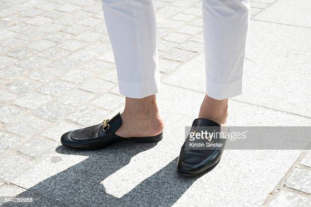 Editor from Bureau 24/7 Norman Tan wears Ralph Lauren trousers and Gucci shoes on day 2 of Paris Collections Men on June 23 2016 in Paris France...