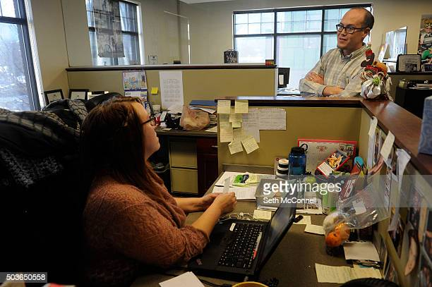 Editor Glenn Wallace talks with reporter Crystal Anderson about story ideas and coverage in the newsroom at the Golden Transcript in Golden Colorado...