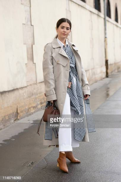 Editor in chief at Blank Itinerary Paola Alberdi wears all Loewe with Salvatore Ferragamo boots on March 01 2019 in Paris France