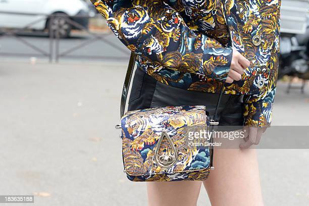 Editor in chief at Ketchup magazine Kat Yeung wearing a Kenzo jacket and bag on day 9 of Paris Fashion Week Spring/Summer 2014 Paris October 02 2013...
