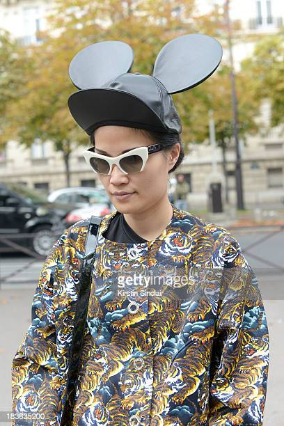 Editor in chief at Ketchup magazine Kat Yeung wearing a Kenzo jacket Miu Miu sunglasses Comme Des Garcons hat on day 9 of Paris Fashion Week...