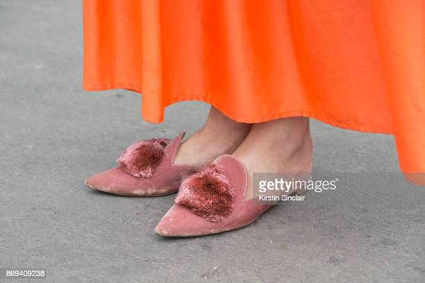 Editor in Chief at Tank Magazine Caroline Issa wears a Dusan dress and Aquazzura shoes day 3 of Paris Womens Fashion Week Spring/Summer 2018 on...