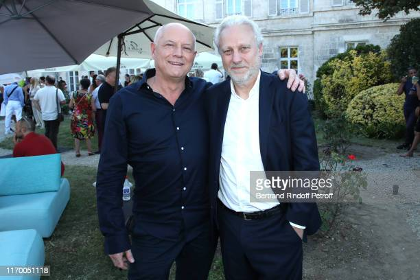 Editor in Chief at TV5 Monde Patrick Simonin and General Director at TV5 Monde Yves Bigot attend the 12th Angouleme FrenchSpeaking Film Festival Day...