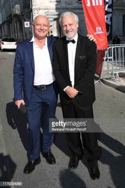 Editor in Chief at TV5 Monde Patrick Simonin and General Director at TV5 Monde Yves Bigot attend the Closing Ceremony of the 12th Angouleme...