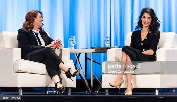 Editor in chief for Glamour magazine Samantha Barry and Human rights lawyer and specialising in international law Amal Clooney speak on stage during...