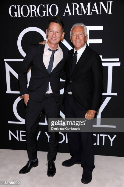 Editor in chief Jim Nelson and fashion designer Giorgio Armani attend Giorgio Armani One Night Only NYC at SuperPier on October 24 2013 in New York...