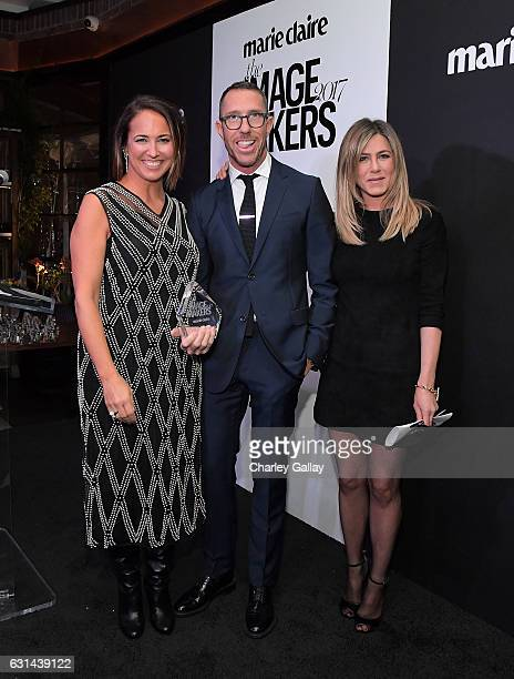Editor in Chief Marie Claire Anne Fulenwider honoree Chris McMillian and actress Jennifer Aniston pose with the ICON Award onstage during Marie...