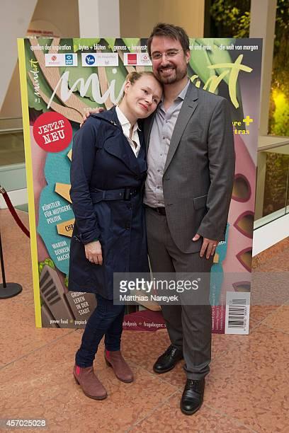 Editor in chief Nicolas Flessa and Anja Schneider attend the 'Mindart' magazine launch party at Kulturkaufhaus Dussmann on October 10 2014 in Berlin...