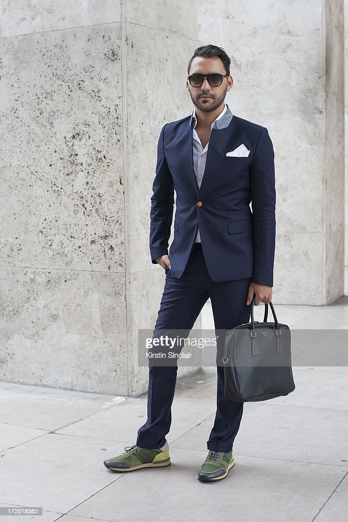 Editor in chief of AMD Mode Ahmad Daabas wears Valentino trainers, Suit and shirt Tailor made in Italy, Prada bag and Persol glasses on day 3 of Paris Collections: Men on June 28, 2013 in Paris, France.