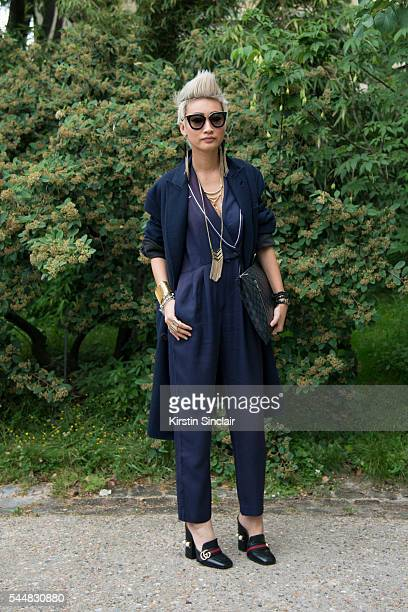 Editor in Chief of Citizen K Arabia Esther Quek wears a Vintage jumpsuit Gucci shoes Louis Vuitton bag Berlutti jacket and Prada sunglasses on day 1...