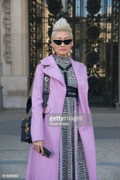 Editor in Chief of Citizen K Arabia Esther Quek wears an Valentino coat and dress, Dior bag and Le Specs sunglasses day 5 of Paris Womens Fashion...