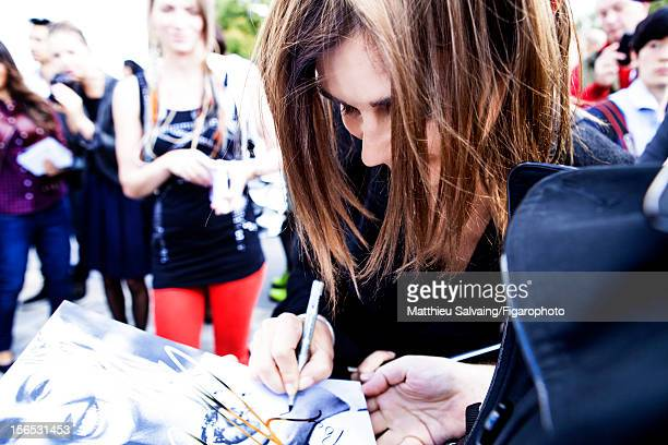 Editor in Chief of CR FashionBook Carine Roitfeld is photographed signing autographs for Madame Figaro on September 27 2012 during Paris Fashion Week...