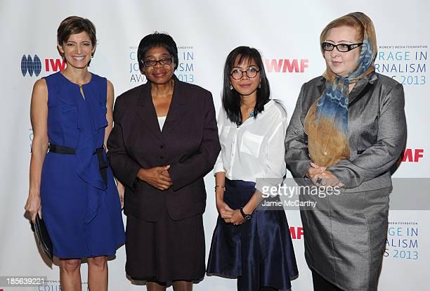 Editor in Chief of Glamour Magazine Cindi Leive Honoree Edna Machirori Honoree Bopha Phorn and Honoree Najiba Ayubi attend the International Women's...