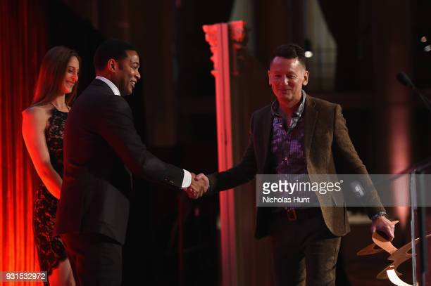 Editor in Chief of GQ Jim Nelson accepts an award from Don Lemon onstage during the Ellie Awards 2018 on March 13 2018 in New York City