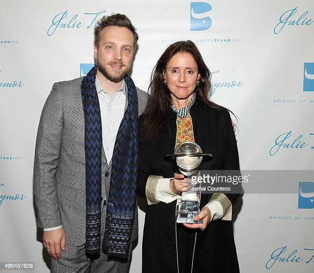 Editor in Chief of Instyle Magazine Ariel Foxman and Director Julie Taymor pose with the Building Bridges Award at the Bridges of Understanding's...