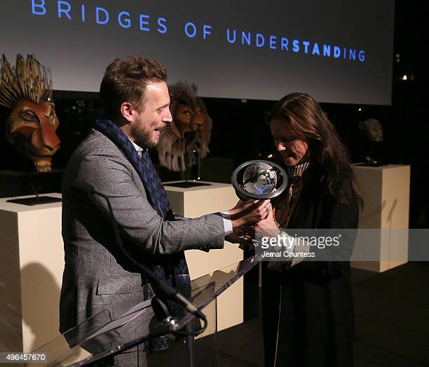 Editor in Chief of Instyle Magazine Ariel Foxman presents the Building Bridges award to Director Julie Taymor at the Bridges of Understanding's...