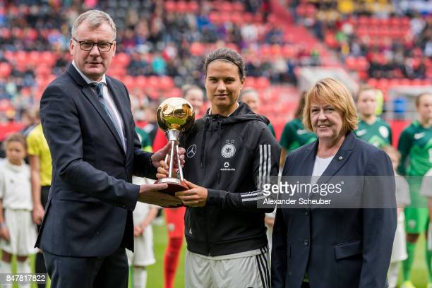 Editor in chief of Kicker Joerg Jakob and DFB Vice President Hannelore Ratzeburg overhand the trophy 'Player of the year' to Dzsenifer Marozsan of...