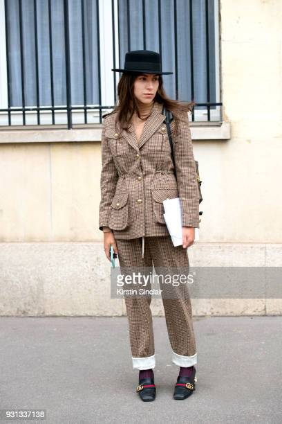 Editor in chief of L'official Ukraine Ulyana Boyko wears a Flow the label suit Dior hat Gucci shoes day 2 of Paris Womens Fashion Week Spring/Summer...