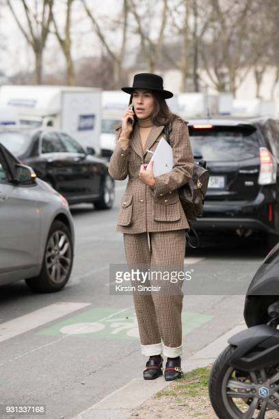 Editor in chief of L'official Ukraine Ulyana Boyko wears a Flow the label suit Dior hat Gucci shoes and a Louis Vuitton bag day 2 of Paris Womens...