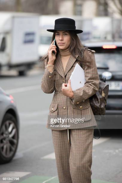 Editor in chief of L'official Ukraine Ulyana Boyko wears a Flow the label suit Dior hat and a Louis Vuitton bag day 2 of Paris Womens Fashion Week...