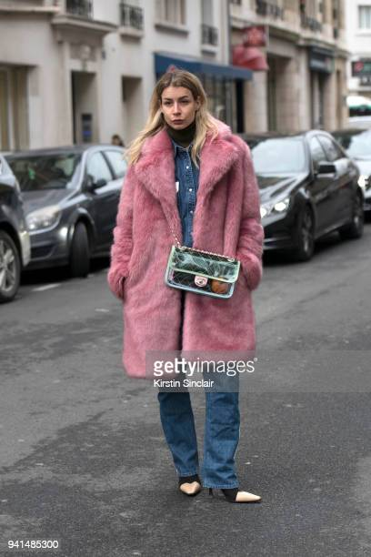 Editor in chief of MINT Irina Lakicevic wears a Hope jacket Chanel bag and Céline boots day 4 of Paris Womens Fashion Week Spring/Summer 2018 on...