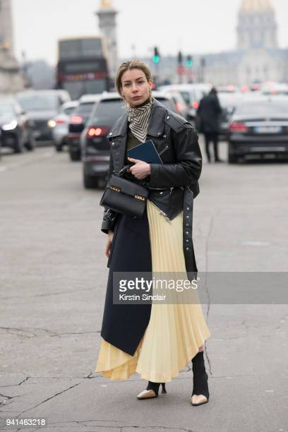 Editor in chief of MINT Magazine Irina Lakicevic wears a Celine skirt and boots Balenciaga jacket Totome scarf and a Delvaux bag day 4 of Paris...