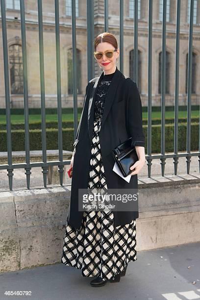 Editor in chief of Refinery 29 Christene Barbarich wears a Rachel Comey coat Dries Van Noten bag and Antonio Marras dress on day 4 of Paris...
