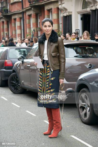 Editor in chief of Tank magazine Caroline Issa wears a Bali jacket Boden skirt Equipment top Chloe bag and Burak Uyan boots on day 4 of London Womens...