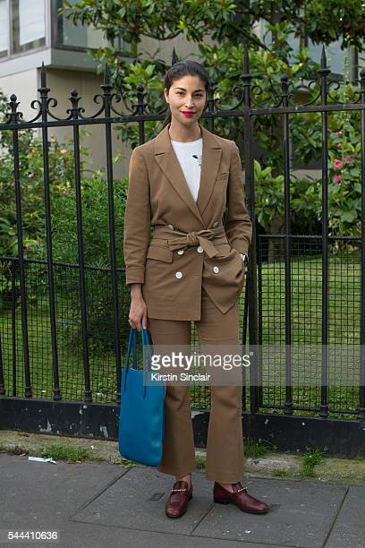Editor in chief of Tank Magazine Caroline Issa wears a Barbara Casasola suit Nina Ricci bag and Gucci shoes on day 3 of Paris Collections Men on June...