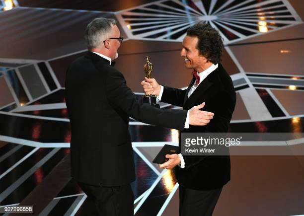 Editor Lee Smith accepts Best Film Editing for 'Dunkirk' from actor Matthew McConaughey onstage during the 90th Annual Academy Awards at the Dolby...