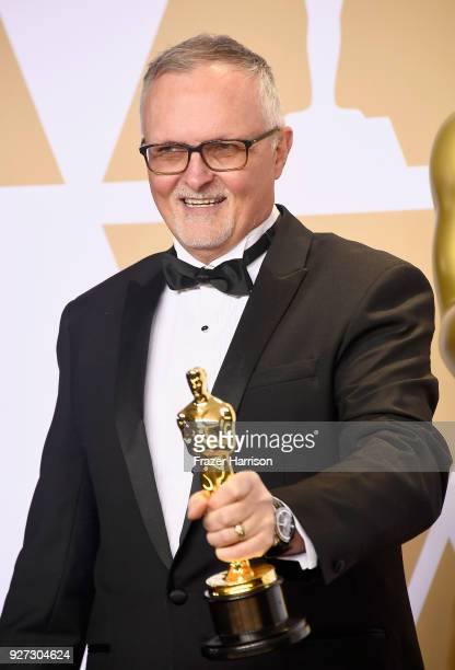 Editor Lee Smith winner of the Best Film Editing award for 'Dunkirk' poses in the press room during the 90th Annual Academy Awards at Hollywood...