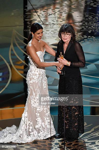 Editor Margaret Sixel accepts the Best Film Editing award for 'Mad Max Fury Road' from actress Priyanka Chopra onstage during the 88th Annual Academy...