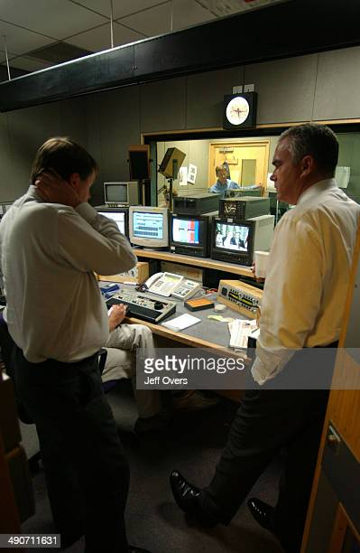 Editor Mark Popescu and Huw Edwards in the edit suite
