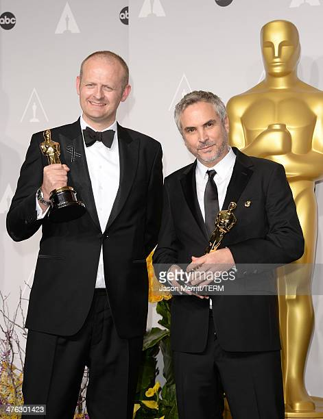 Editor Mark Sanger and director Alfonso Cuarón winners of Best Achievement in Editing pose in the press room during the Oscars at Loews Hollywood...