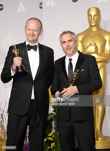 Editor Mark Sanger and director Alfonso Cuaron winners of Best Achievement in Editing pose in the press room during the Oscars at Loews Hollywood...