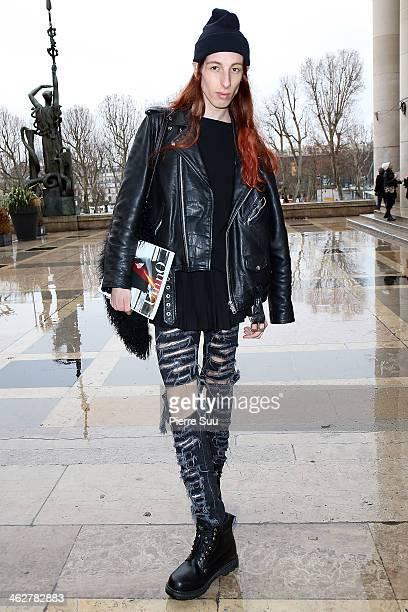 Editor of Umno Magazine Domino wearsHM Trousersvintage Bootsvintage leather JacketHM SkirtMango BagDKNY Jumper on January 15 2014 in Paris France