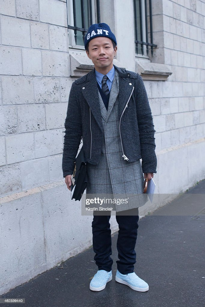 Editor of Women's Wear Daily Japan Kaname Murakami wears United Arrows pants, Bottega Veneta slip-on sneakers, Newneu clutch, and Gant hat on day 2 of Paris Haute Couture Fashion Week Spring/Summer 2015, on January 26, 2015 in Paris, France.