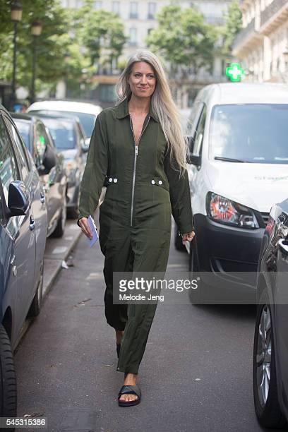 Editor Sarah Harris wears a green jumpsuit at the Jean Paul Gaultier show on July 6 2016 in Paris France