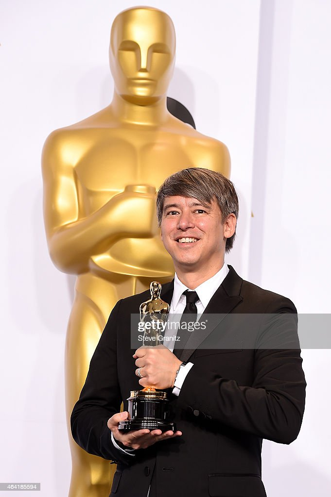 Editor Tom Cross poses in the press room during the 87th Annual Academy Awards at Loews Hollywood Hotel on February 22, 2015 in Hollywood, California.