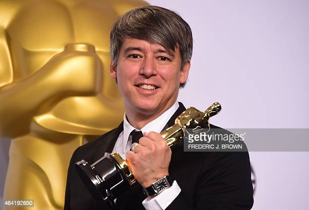Editor Tom Cross winner for the Best Film Editing Award for Whiplash poses in the press room during the 87th Oscars on February 22 2015 in Hollywood...