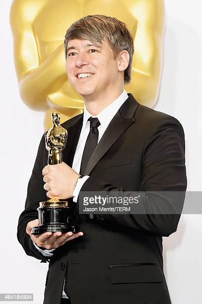 Editor Tom Cross winner of the Best Film Editing Award for 'Whiplash' poses in the press room during the 87th Annual Academy Awards at Loews...