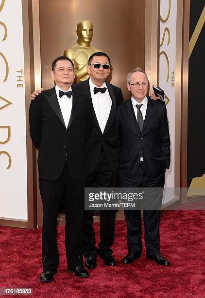 Editor William Chang Suk Ping director Wong Karwai and cinematographer Philippe Le Sourd attend the Oscars held at Hollywood Highland Center on March...