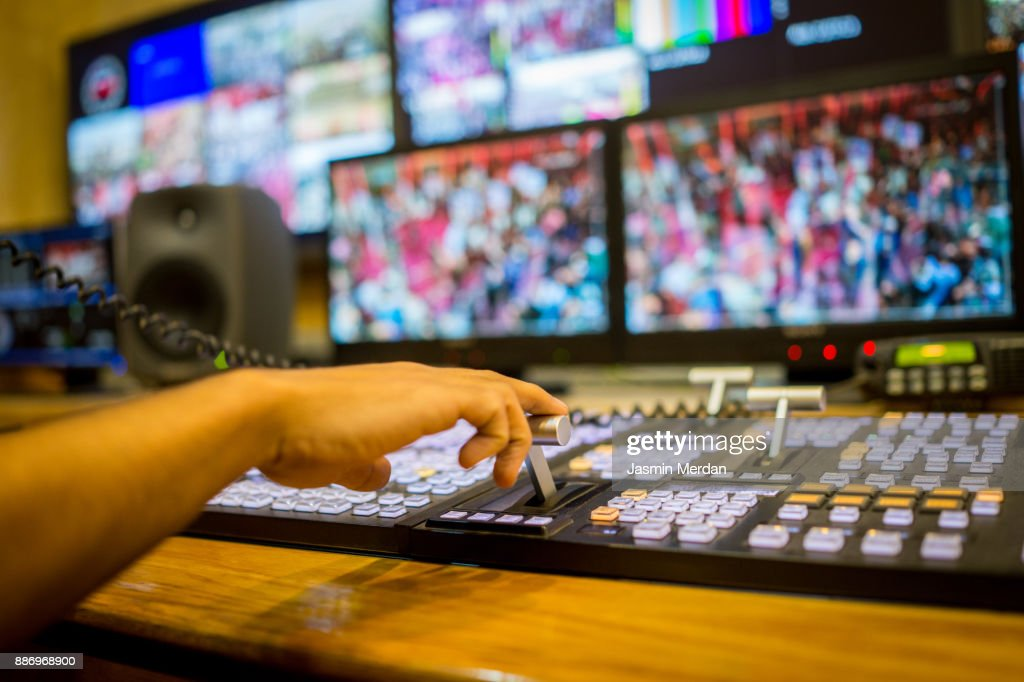 TV editor working with vision mixer in television broadcast gallery : ストックフォト