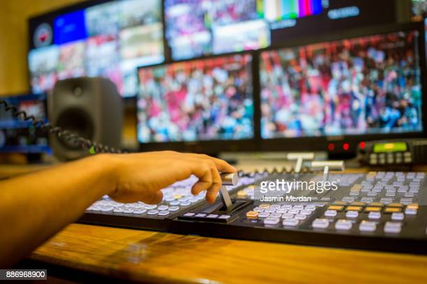 tv editor working with vision mixer in television broadcast gallery - 放送 ストックフォトと画像